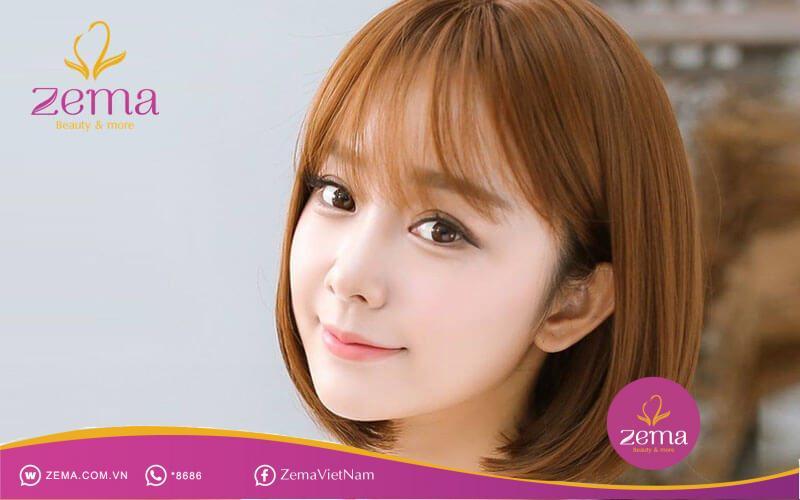 Uốn tóc ngắn cụp kết hợp mái thưa phù hợp với nhiều khuôn mặt và màu da