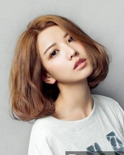 Tóc ngắn uốn phồng khiến tóc dày dặn hơn