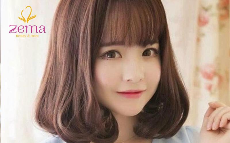 Kiểu tóc này giúp che đi khuyết điểm của gương mặt tròn.