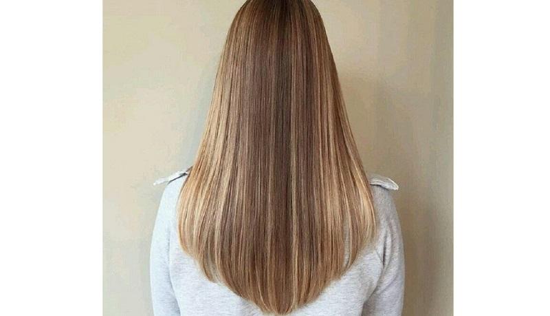 Kiểu tóc cụp đuôi ép dài ngang lưng hình chữ V được nhiều người yêu thích