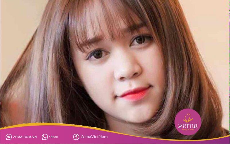 Kiểu tóc ngắn uốn cụp luôn giúp nàng mặt tròn thêm phần trẻ trung