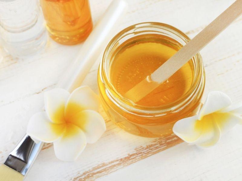 Cách tẩy lông bằng mật ong và đường